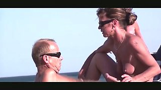 Horny mature couple in hot sex on the beach action
