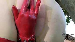 Latex Lucy in latex suit is fingering cunt