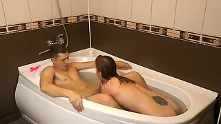 Young Couple In The Bathroom Entertain Each Other By Filming Homemade