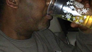 Asian pissing in a cup for black guy to drink