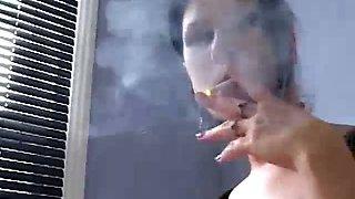 Brunette babe smoking while interrogating