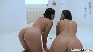 Two busty babes are walking around, take a lesbian shower and share a cock