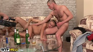 Bodacious blondie takes on two hard cocks at once after a night of partying