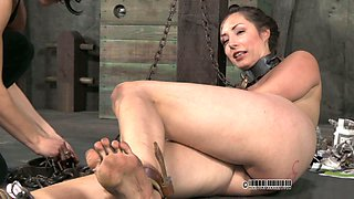 Chained submissive sex slave sitting with her legs wide open