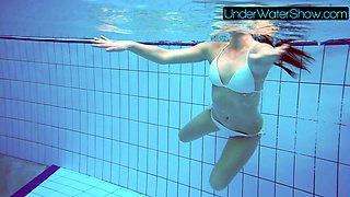 Sexy cute beauty Alla swims in the swimming pool