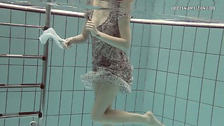 Cute European teenie caught on cam in the pool underwater