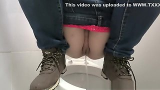 pissing a young girl in a public toilet