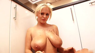 My charming girlfriend pours milk all over her big tits in the kitchen