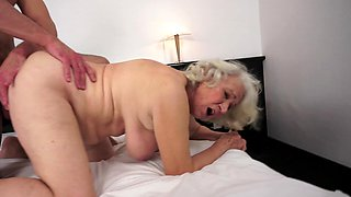 Gray old woman is getting her pussy licked and she is moaning loudly