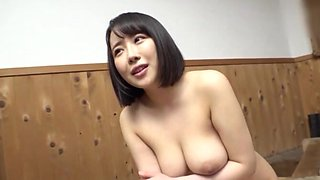 Good looking Japanese brunette sucking a dick in the living-room