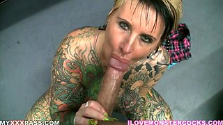 Extravagant tattooed and pierced whore gives blowjob