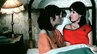 Two brunettes please each other with cunni in retro video