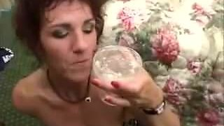 Old broad drinks the cum
