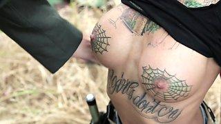 After being captured, busty tattooed vixen Bonnie Rotten