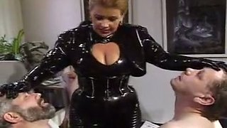 Short haired white blonde milf in latex body teases mature guy
