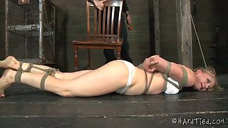 Sweet looking blonde is tied up before getting her muff punished