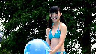 Adorable Asian girl with slim body Mizuki Moe swims in the pool