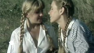 Blonde European babes in lesbian softcore scene outdoors