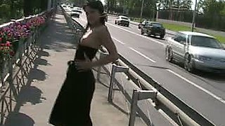 Fantastic white brunette teen in black dress flashes her pussy on the sidewalk