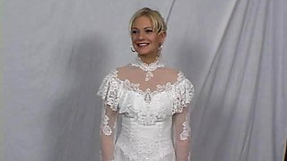 A slutty bride gets fucked by a guy at the dress shop