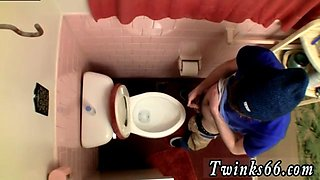 Twink is being spied while taking a piss in toilet
