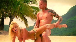 A girl is doing doggy style sex on the beach with her man