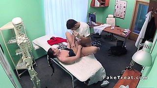 Doctor worships feet to brunette patient