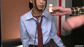 Japanese schoolgirl Chika is on her knees chained to a pole