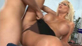 Horn-mad secretary Puma Swede gets fucked from behind right on the table