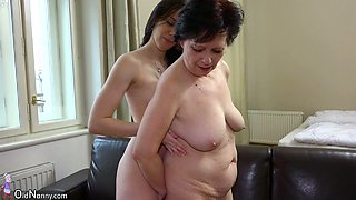 Nasty old whore with saggy titties lets her lesbian GF fuck her with a strap on