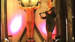 Submissive male gets flogged by an evil dominatrix