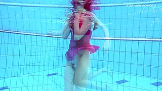 Redhead stunner Anna Netrebko bathing in a pool