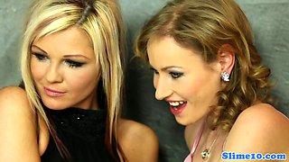 Gloryhole loving lesbians licking during cum