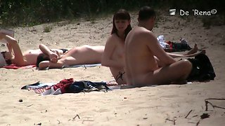 Nudist girl is topless while her partner is absolutely nude