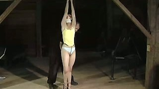 Red haired sex-slave is tied up and restrained