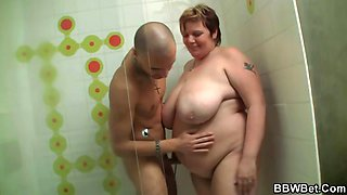 Huge BBW gives head and gets banged in the shower