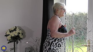 Busty mature blonde granny Claire Knight plays with her pussy