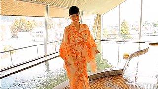 Mesmerizing Oriental girl sensually exposes her perfect body