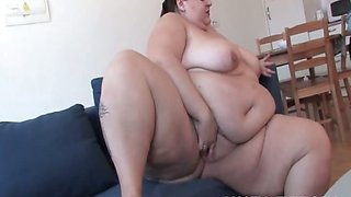 Mature teasing boobs with big dildo