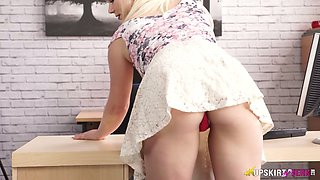 Cute secretary Megan bends over and shows her charming plump pussy