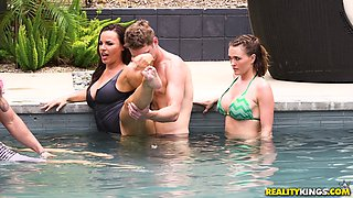 Dana DeArmond and Krissy Lynn seduce a guy for a fuck at a pool