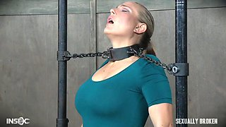 master and mistress play with their blonde slave
