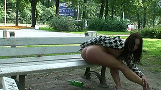 Magnificent Russian girl with long legs flashes her goodies on the bench