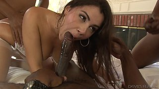 Daring brunette coping with three monster cocks in an interracial foursome