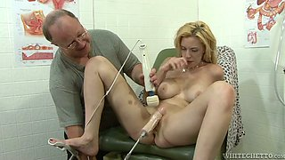 Nasty blonde testing fuck machine and new sex toy sitting on a gynochair