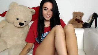 Sensual brunette schoolgirl spreads her sexy slim legs for