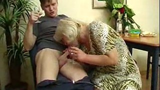Young guy pleasing fat Russian housewife on the couch