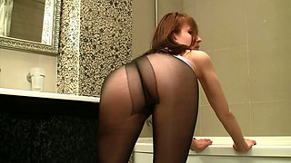 Cute lonely and charming red haired gal exposes her nice ass in pantyhose
