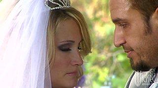 Delicious blond bride Nicole Ray is blowing big cock after wedding