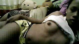 Dark skin FIlipina slut flashes her small boobs on webcam